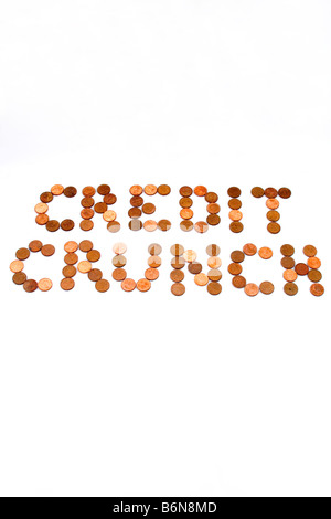 Concept of words 'Credit Crunch' spelled out in pennies on white background symbolizing lean times - Stock Photo