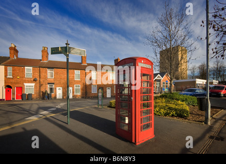 Old fashioned red telephone box at the corner of Westgate and Burton Road, Lincoln - Stock Photo