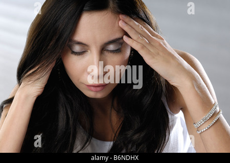 Woman experiencing a headache - Stock Photo