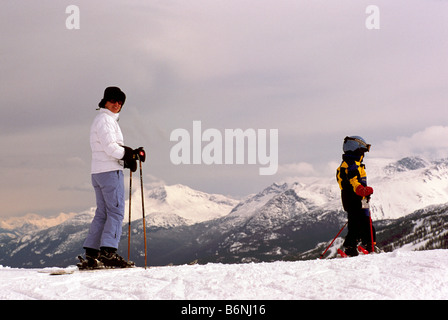 Young Child learning to Downhill Ski with Mother on Blackcomb Mountain at Whistler Ski Resort British Columbia Canada - Stock Photo