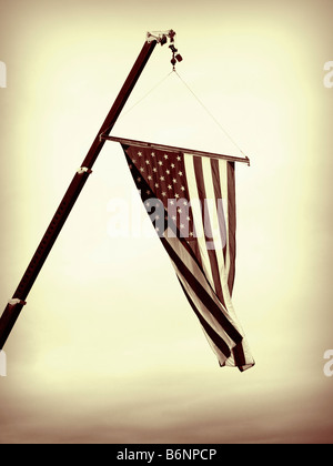 A close up on the American flag suspended from a crane - Stock Photo