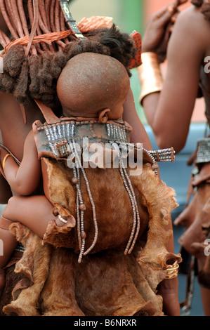 himba woman with baby opuwo namibia - Stock Photo