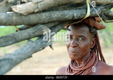 himba woman in village near opuwo namibia - Stock Photo
