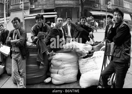 These workers too but on a smile for the camera... people like them who are at the greatest immediate risk If you - Stock Photo