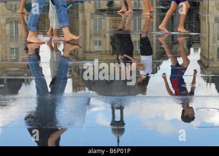 Bordeaux France Ornamental water feature on Quai de la Douane and Place de la Bourse in the background - Stock Photo