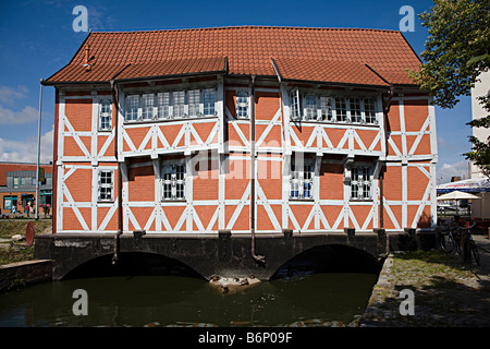 Old style timbered building spanning canal Wismar Germany - Stock Photo