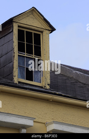 Windows are missing from the cupula of an old building in the New Orleans French Quarter. - Stock Photo