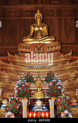 Buddha statue in Buddhist temple in Bangkok's Chinatown, Thailand. The Buddha is in Subduing Mara position. - Stock Photo