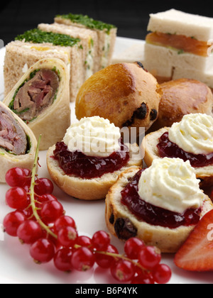 Scones and sandwiches for afternoon tea - Stock Photo