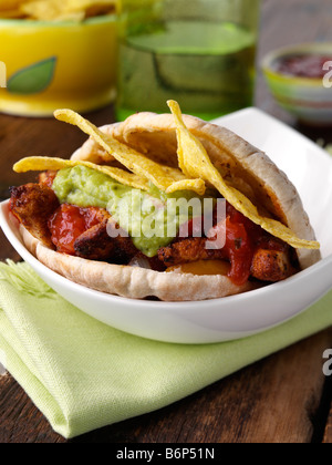 Deep fried spicy chicken in pitta bread wrapped editorial food - Stock Photo
