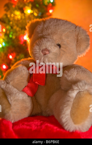Teddy Bear in front of Christmas Tree - Stock Photo