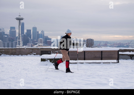 Woman using cross country skis in snow on Queen Anne Hill Seattle Washington - Stock Photo
