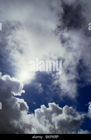 Dramatic white clouds against a blue sky - Stock Photo