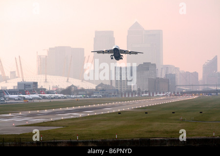BAe 146 Taking Off - London City Airport - Docklands - Stock Photo