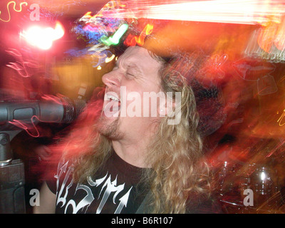 Kevin Lawless of the locally famous Bar band 'Liplock' sings during a show in West Haven Connecticut USA - Stock Photo