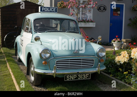 Morris Minor in show garden at Malvern Spring Flower Show 2008 - Stock Photo