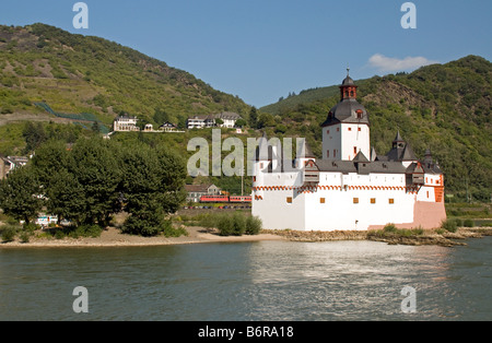 Pfalz Fortress on Rhine River at Kaub with intercity train in background - Stock Photo