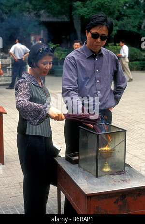 Chinese people, tourists, burning incense, joss sticks, religious offering, Lama Temple, Yonghegong, Beijing, Beijing - Stock Photo