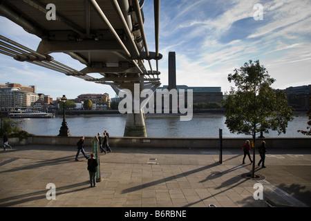 View from beneath the Millennium Bridge towards the Tate Modern Gallery, London, England. - Stock Photo