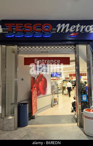 Tesco Metro supermarket entrance Canary Wharf London - Stock Photo