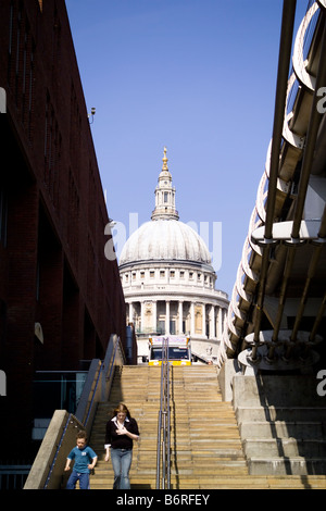 Steps that lead up to the Millennium Bridge on the north side of the River Thames with St Paul's Cathedral beyond, - Stock Photo