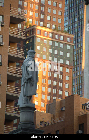 Statue of Columbus in New York City with skyscrapers around it - Stock Photo