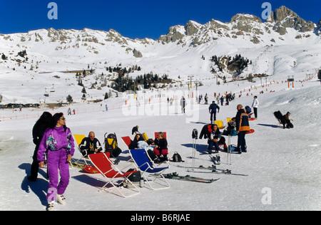 Skiers relaxing at skiing area at Passo di San Pelegrino in Marmolada mountain group Dolomites Trentino Alto Adige - Stock Photo