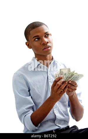 African man holding and counting money isolated - Stock Photo