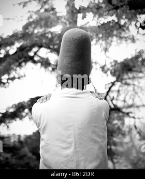 Dervish dancer crossing his arms. Rear view. Istanbul. Turkey - Stock Photo
