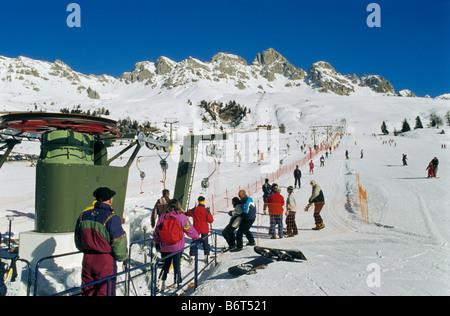T-bar lift at skiing area at Passo di San Pelegrino in Marmolada mountain group in winter Dolomites Trentino Alto - Stock Photo