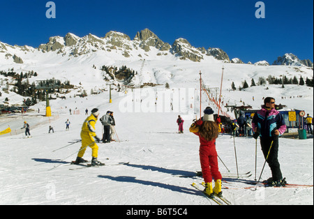 Skiing area at Passo di San Pelegrino in Marmolada mountain group in winter Dolomites Trentino Alto Adige region - Stock Photo