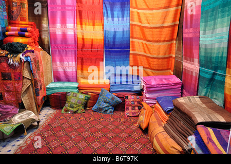 Colorful fabrics for sale in Fes, Morocco - Stock Photo