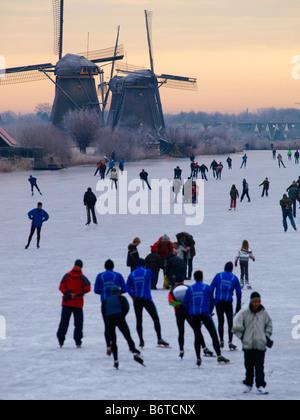 Many people skating on natural ice Kinderdijk the Netherlands - Stock Photo