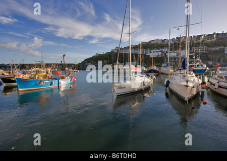 Sailing and fishing boats at anchor in the inner harbour at Mevagissey Cornwall - Stock Photo