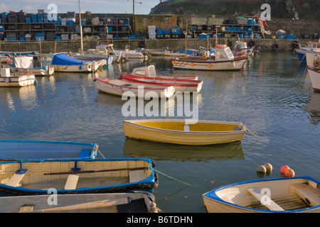 Fishing boats and dinghies in the inner harbour at Mevagissey, Cornwall - Stock Photo