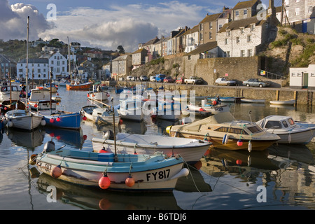 Boats at anchor in the inner harbour at Mevagissey Cornwall - Stock Photo