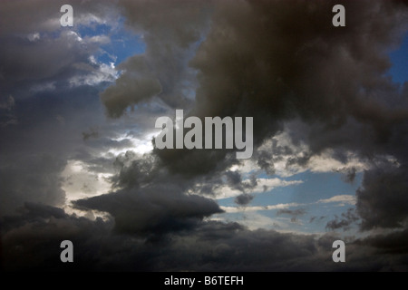 Dramatic storm clouds against a background of blue sky - Stock Photo