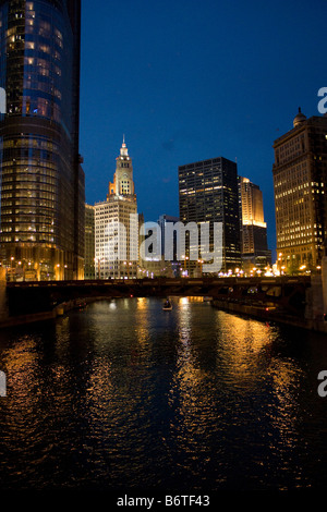 Looking east on Chicago River from Wells Street bridge at dusk - Stock Photo