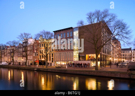 Anne Frank Huis, House and Museum on the Prinsengracht Canal in Amsterdam, the Netherlands; Holland. At dusk in - Stock Photo