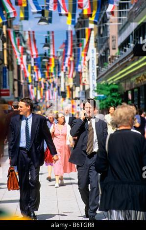 SWEDEN STOCKHOLM BUSINESSMEN ON DROTTNINGGATAN STREET - Stock Photo