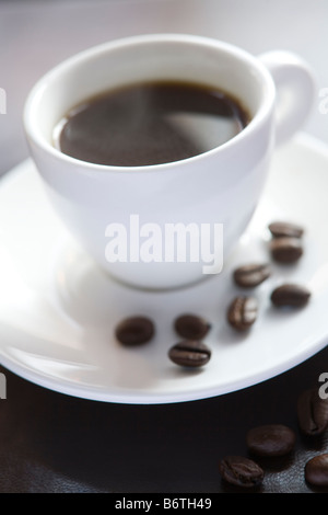 Cup Of Espresso With Coffee Beans - Stock Photo