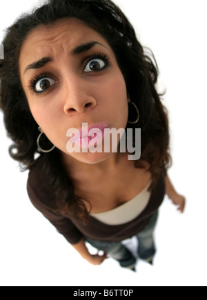 A teenage girl with a funny expression The picture was taken with fisheye lens - Stock Photo
