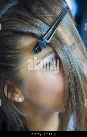 Woman getting her hair done. - Stock Photo