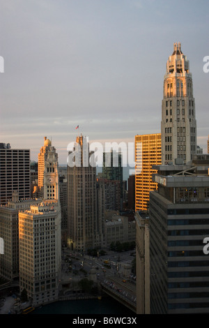 Elevated view of Wrigley Building Chicago River and Michigan Avenue bridge at sunset - Stock Photo