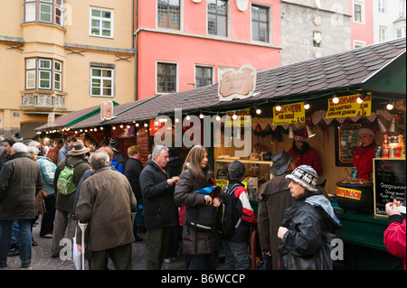 Gluhwein stall at the Christmas Market in the old town (Altstadt), Innsbruck, Tyrol, Austria - Stock Photo