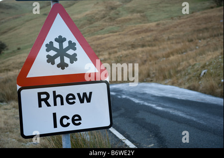 Bilingual welsh english road sign warning of Ice on the road Cwm Ystwyth mid wales - Stock Photo