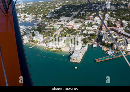 Aerial view of Duval St in Key West Florida looking south from biplane - Stock Photo