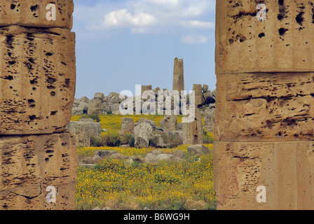 Temple F ruins from Temple E at Eastern Zone of Valley of Temples in Selinunte in spring Sicily Italy - Stock Photo
