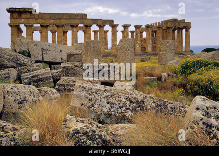 Temple E seen from Temple F ruins at Eastern Zone of Valley of Temples in Selinunte Sicily Italy - Stock Photo