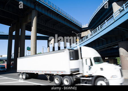 A lorry on a highway - Stock Photo